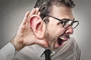 A man with an over sized ear listening like a sales champion