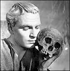A picture of a shakespearean actor holding a human skull